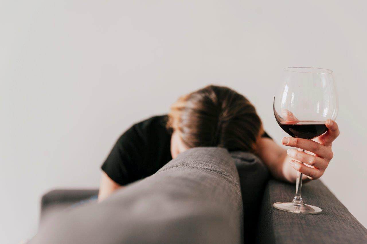woman passed out due to drinking too much wine
