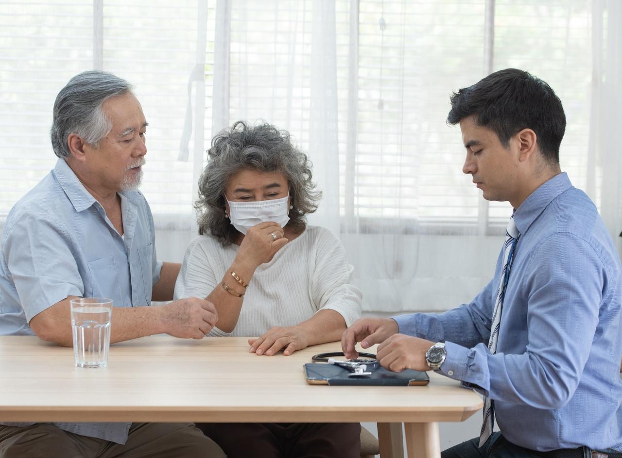 Asian grandparents attending a regular checkup