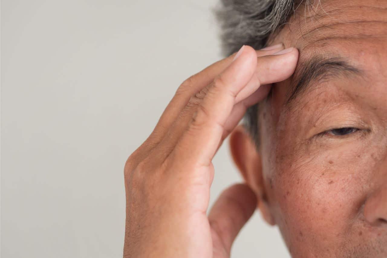 Senior man experiencing headache