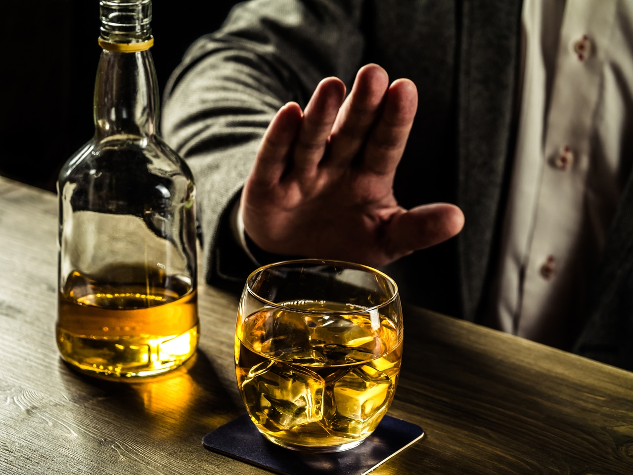 Man saying no to whiskey