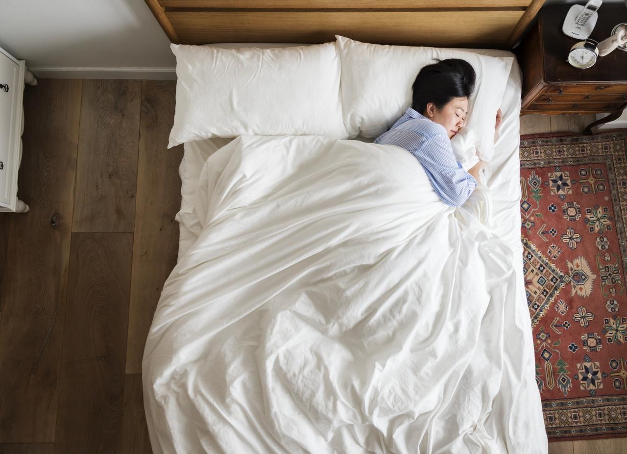 Asian woman having a hard time sleeping