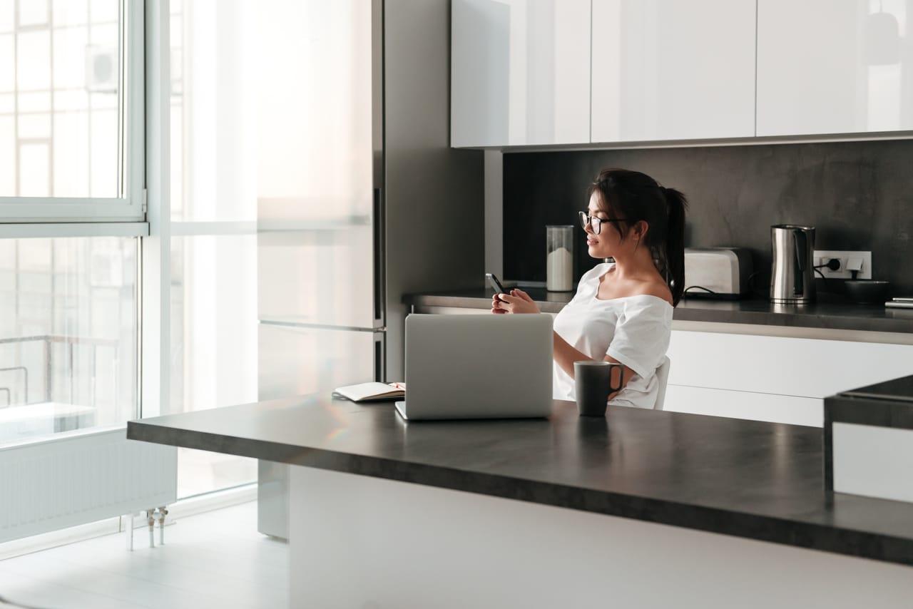 A woman taking a break from her laptop