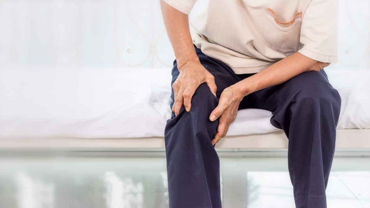 Man experiencing leg pain